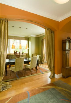 dining room with table and chairs and long curtains
