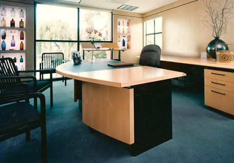 office with a desk and a few chairs